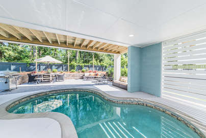 Heated pool with a huge outdoor area with everything you could want