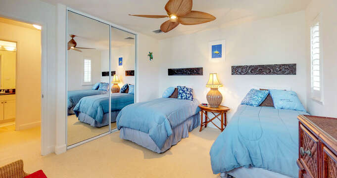 Bedroom with Twin Beds with Blue Linens