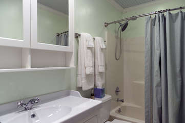 The hall bath has a tub/shower combo and single vanity.