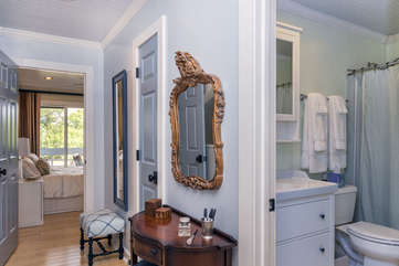 Off the upstairs hall, you will find a hall bath and an additional guest bedroom.