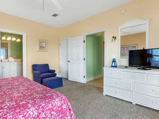 South bedroom dresser and flat panel tv. Private bath.