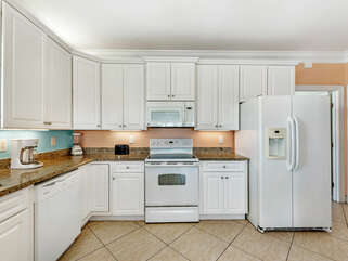 Everything you need for beach cooking. Stovetop, oven, microwave, dishwasher, and 2 fridges.