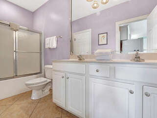 Bathroom 1 on Main level with private access from Bedroom 1 and access from Living areas