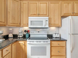 Beach Castle West Kitchen, coffee pots, stove, microwave and 1 of 2 refrigerators