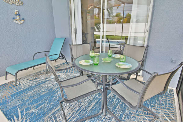 Shaded lanai area with glass patio table