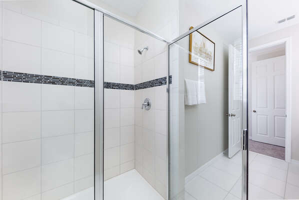 En suite bath with double vanity sins and sizable shower