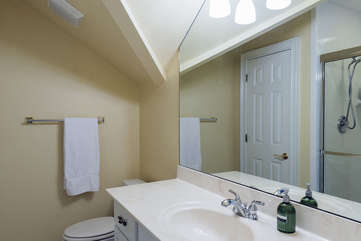 A full bath with tub/shower combo if off the bonus room.