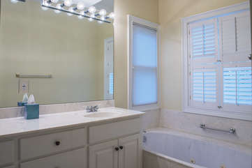 The master bath features double vanity sinks, a soaking tub and large shower.