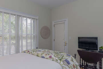 This guest bedroom has access to the screen porch.