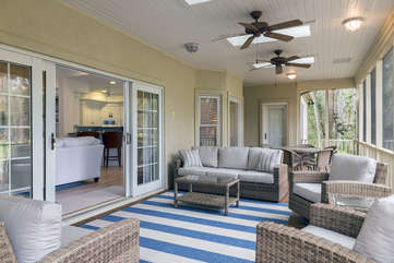 The screen porch stretches across the back of the house bringing the outside in.  You may relax and dine in this beautiful room.