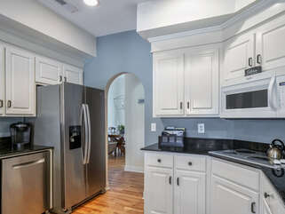 Granite counter tops and white cabinetry make this kitchen a treat for any gourmet chef.