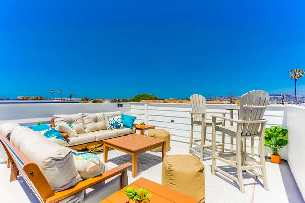 Roof top patio of this Vacation Home Rental in San Diego with Bay views, comfortable outdoor furniture
