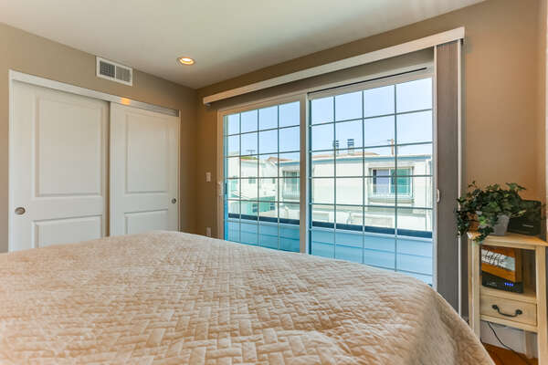 2nd floor bedroom, KING bed, and a great view onto the private patio.