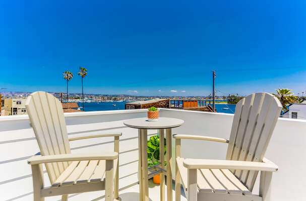 Roof top patio with Bay views, comfortable outdoor furniture overlooking the surrounding area.