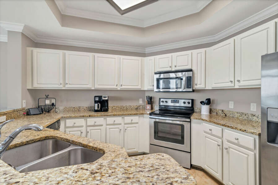 The Fully Equipped, Spacious Kitchen has Stainless Steel Appliances and Granite Counter Tops