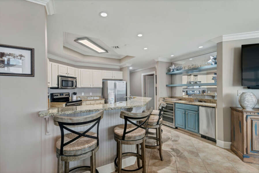The Fully Equipped, Spacious Kitchen and Wet Bar have Stainless Steel Appliances and Granite Counter Tops. Wet Bar has separate Ice Maker and Sink.