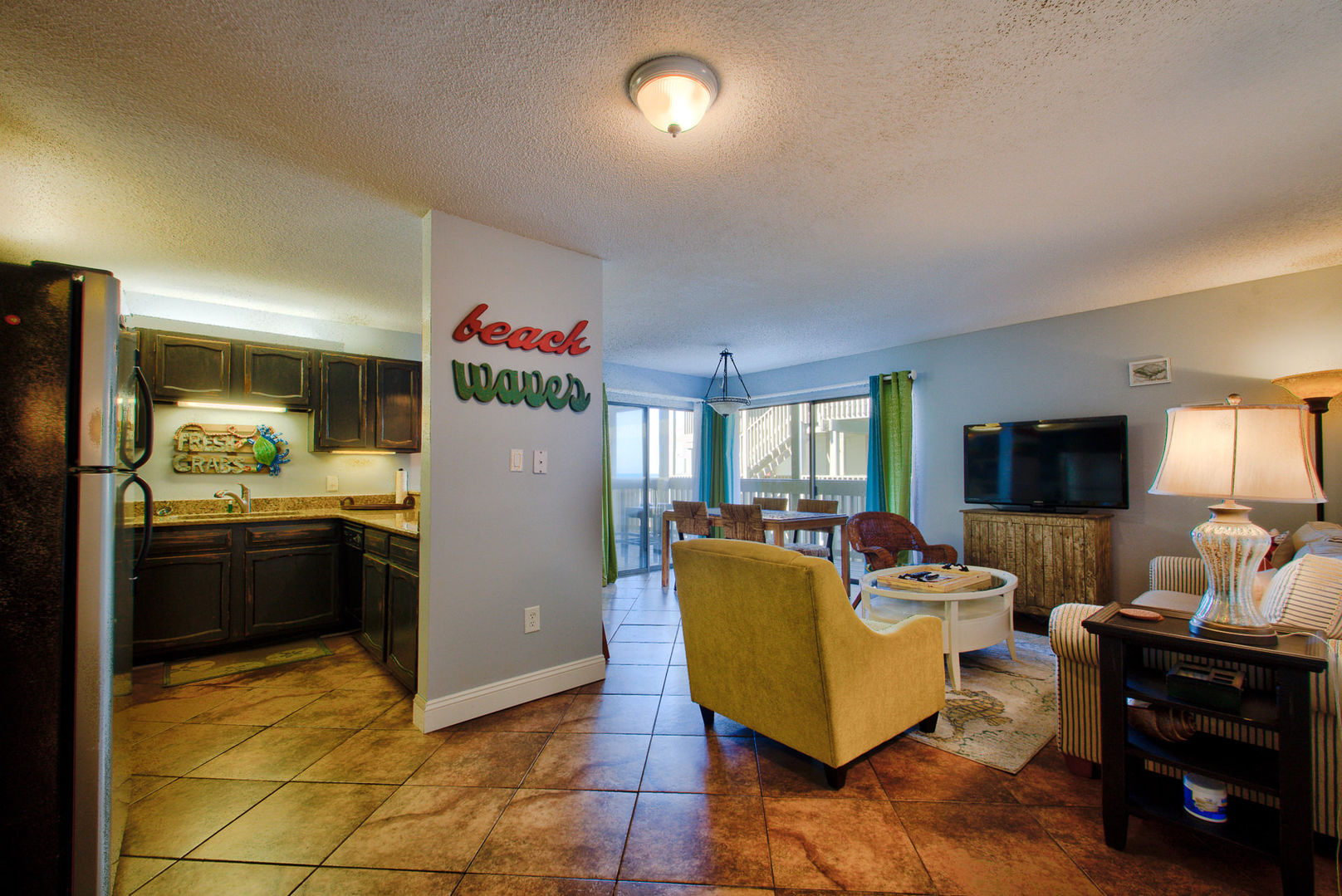 View of Living Area and Kitchen in our Gulf Shores, AL Vacation Condo
