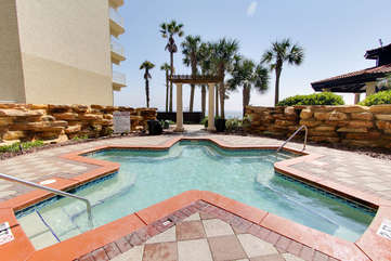 Hot tub located on pool deck