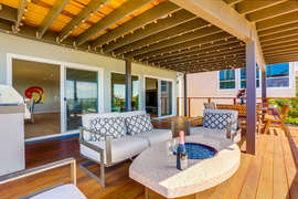 MAIN DECK LIVING WITH FIRE PIT AND EIGHT PERSON OUTDOOR DINING