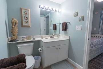 Full guest bathroom attached to twin trundle bed area