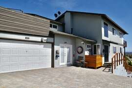 TWO CAR GARAGE WITH TWO SEPERATE ENTRANCES AND SECLUDED REAR ROOF DECK