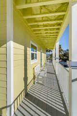 Two stories of wrap around decks