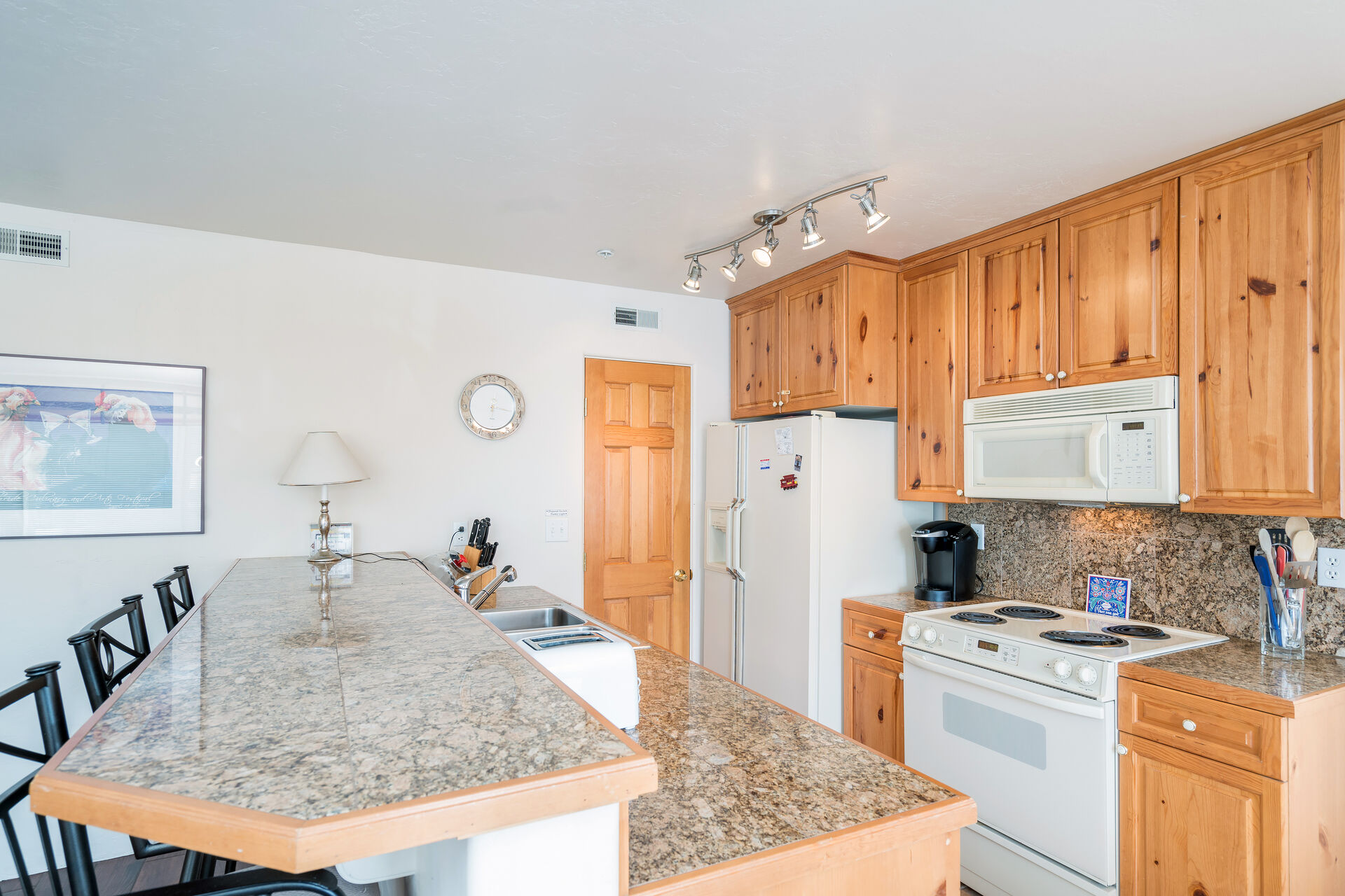 Full Kitchen with Wooden Cabinetry at Outlaws #7A