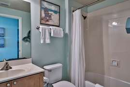 Full bathroom with shower/tub combination attached to bunk room