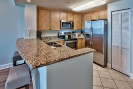 Eat in bar with all granite counter tops and pantry
