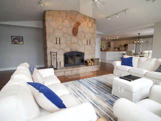 Living Room with wood-burning fireplace, Otter Lake