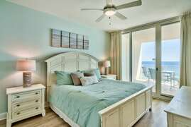 King size bed in the master with a walkout balcony and view