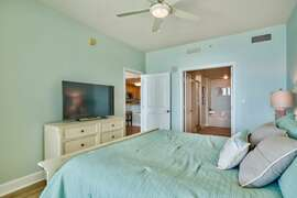 Master bedroom with flat screen TV and full attached bath