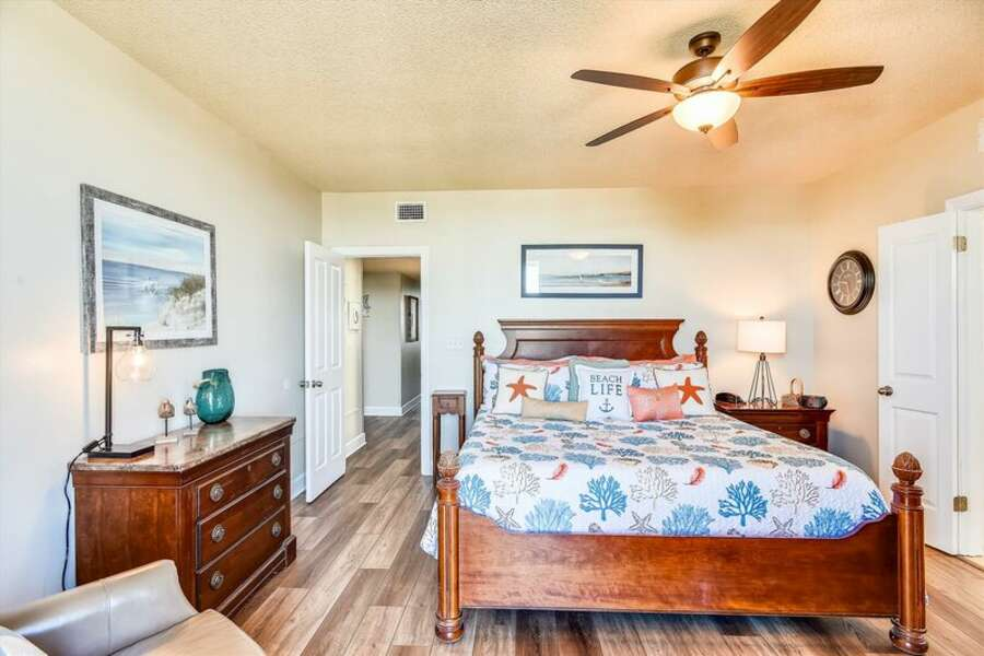Master Bedroom with a King Size Bed has a Private Bath and Balcony
