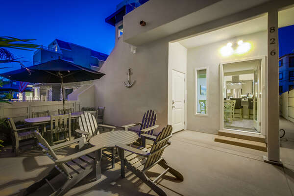 Private Ground Floor Patio with Two Outdoor Dining Sets.