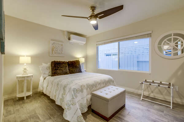 Large Bed, Nightstands, Ceiling Fan, AC, and Window.