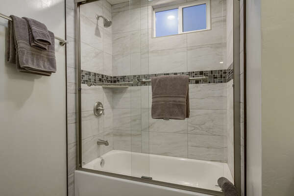 Shower-Tub Combo with Glass Doors.