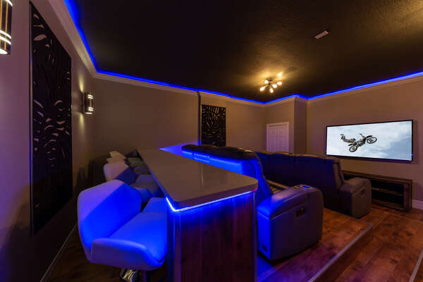 The house provides a media room where you can comfortably recline and enjoy a movie