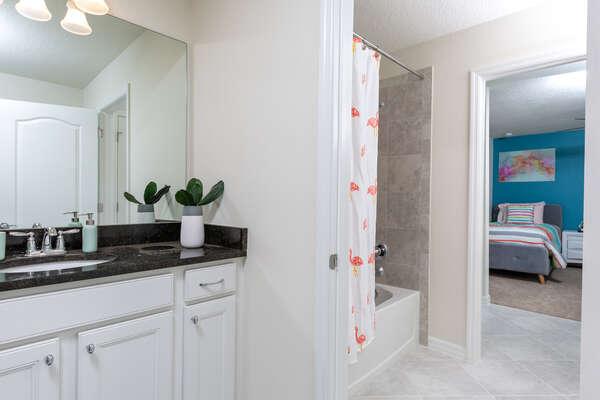 Jack-an-Jill bathroom with combination shower/bathtub