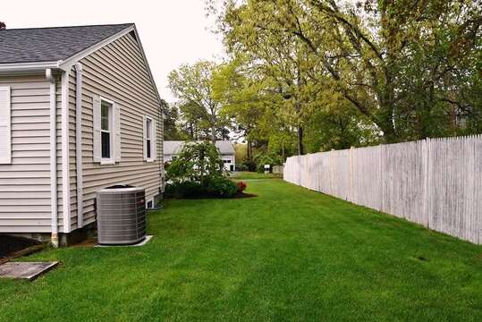 Well manicured lawn - Privacy fence around entire back yard - open to front- 22 Muscovy Lane West Yarmouth Cape Cod - New England Vacation Rentals