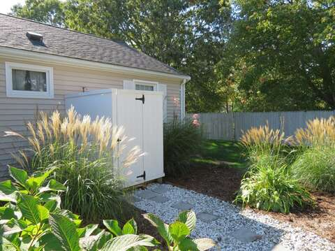 Walkway from the deck to the enclosed outdoor shower-22 Muscovy Lane West Yarmouth Cape Cod - New England Vacation Rentals