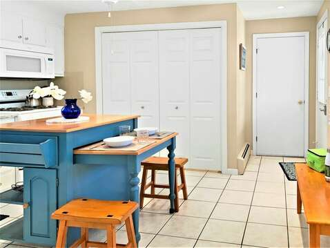 Fully equipped kitchen with convenience of the washer dryer behind double doors - 22 Muscovy Lane West Yarmouth Cape Cod - New England Vacation Rentals