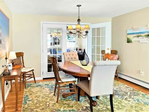 Share a family meal at the dining room table - 22 Muscovy Lane West Yarmouth Cape Cod - New England Vacation Rentals