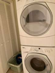 Laundry room with full size washer/dryer located at the top of the stairs.