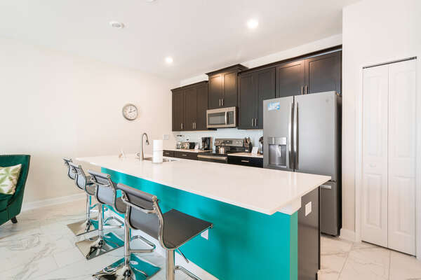 A fully equipped kitchen with breakfast bar for 4
