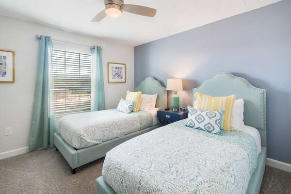 This bedroom features 2 twin beds located on the second floor