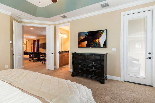 The master suite features a 55-inch SMART 4K TV and access to a balcony