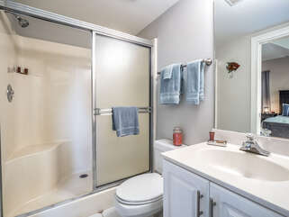 This guest bedroom has a private bath with shower