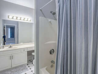 The Jack & Jill bath has double sinks and a tub/shower combination.