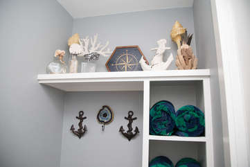 Beach towels included!! Custom shelving and hooks added to place things- anything to make your stay
