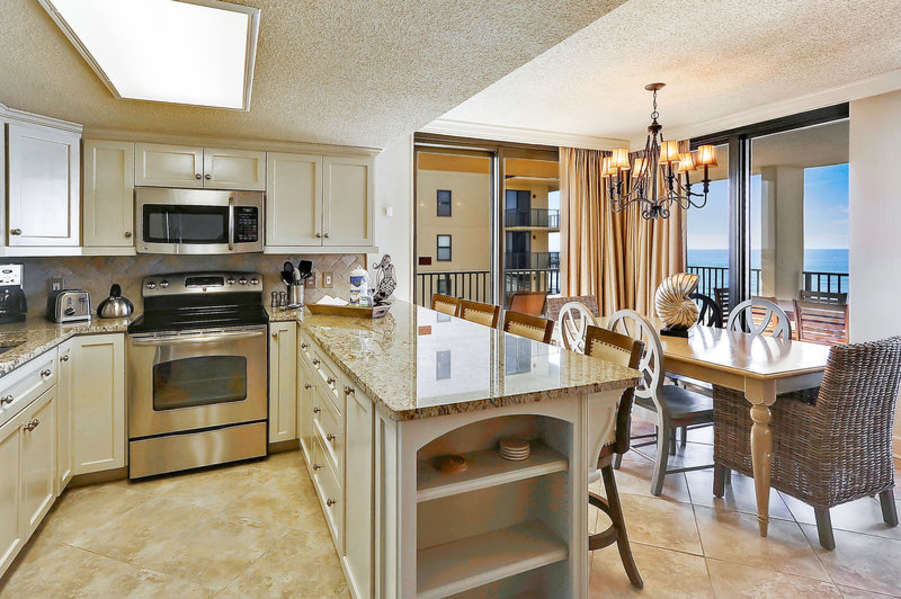 Spacious Kitchen with Stainless Steel Appliances, Granite Counter Tops and Fantastic Views